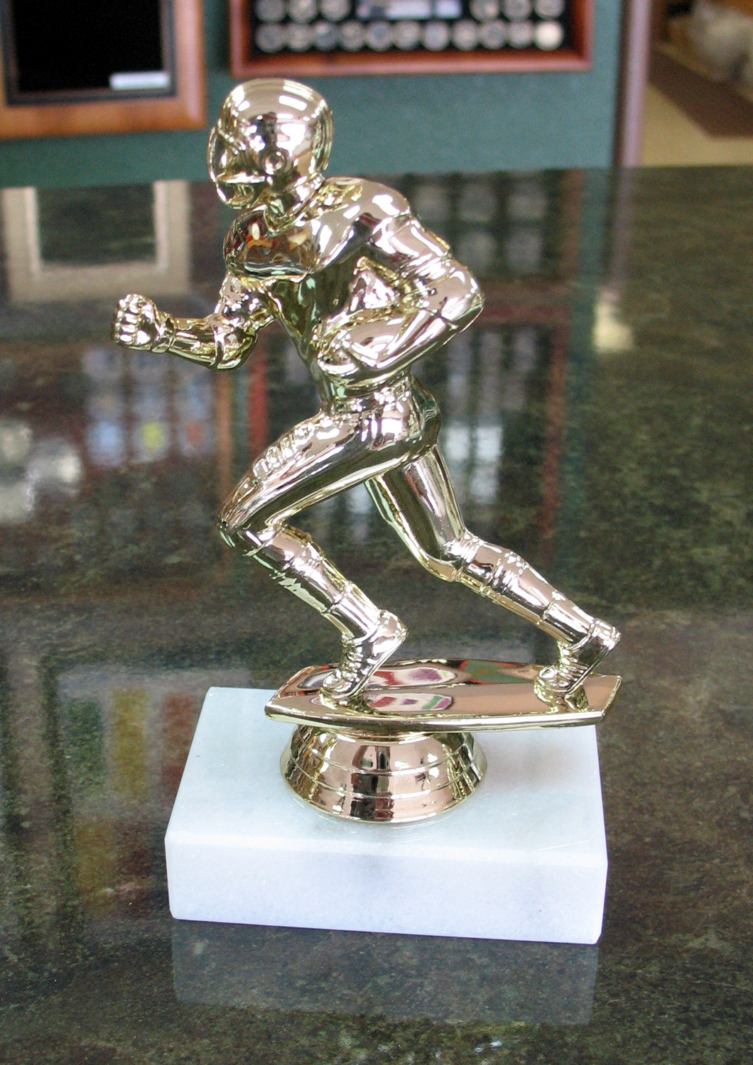 gold football trophy with solid marble base